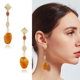 diamante ambra Sconti Fashion Love Designer East Gate Hit Color Secondo Grammo Force Orecchini Geometria Fondo lungo Ambra Diamante Orecchini a forma di orecchini con orecchie di rame per donna