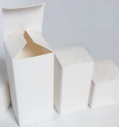 Caja de papel de cartón blanco Pequeños favores de boda Cajas de embalaje de regalo Cajas de almacenamiento de dulces 50 piezas por lote desde fabricantes