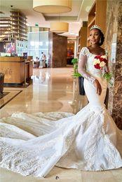 2019 Abito da sposa a sirena a maniche lunghe sexy africana Abito da sposa in tulle elegante con applicazioni di pizzo nero elegante da ragazza plus size da