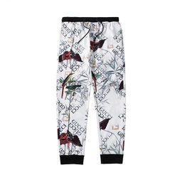 2019 huellas de animales Pantalones de chándal de diseñador para hombre Marcas casuales de cremallera Escultura y Animal Print Pantalones Hip Hop Streetwear Pantalones sueltos Hombres Joggers de lujo rebajas huellas de animales