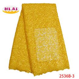 2019 tessuto di sequin giallo 2019 tessuto africano del merletto di alta qualità giallo tessuto di pizzo francese tulle paillettes tessuto di pizzo nigeriano per abito da sposa XY2536B-3 sconti tessuto di sequin giallo