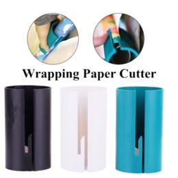 Cortador de rollo online-Envolver rollo de papel cortador de deslizamiento del papel de embalaje del cortador de papel prefecto Línea Wrap Herramientas de Navidad Año Nuevo del papel de regalo Papeles cortador corte