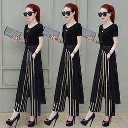 Pierna de perla negra online-2018 nueva señora de la oficina de verano conjunto de 2 piezas, blusa de perlas de gasa negra larga y pantalón a rayas de pierna ancha, elegante pantalón de mujer