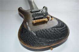geschnitzte gitarren Rabatt Aus China benutzerdefinierte elektrische ji handgeschnitzte Vögel Krähe Adler geschnitzte E-Gitarre, können Sie alle Schnitzmuster anpassen