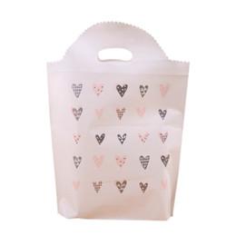 Canada 100PCS / LOT PE sac à provisions en plastique écologique qui se plie portable épaule réutilisable sac à main imprimer amour coeur pour sacs d'épicerie Offre
