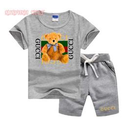 Niño de moda corto online-Logo de la marca Diseñador de lujo Ropa para niños Juegos de verano Ropa de bebé Estampado para niños Trajes Moda para niños pequeños Pantalones cortos para niños Trajes para niños