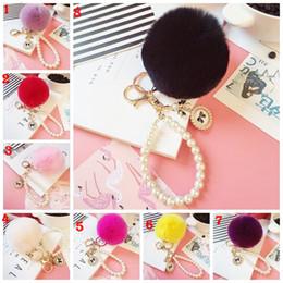 Llavero de bola de piel de conejo real de Fox con colgante del anillo del llavero del coche de la perla para el encanto del bolso desde fabricantes
