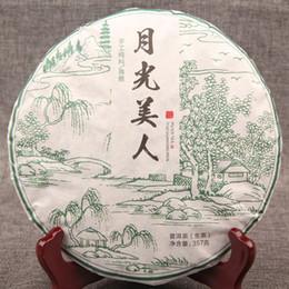 Argentina Venta al por mayor Yunnan Pu'er Tea Moonlight White Cake Pure Handmade Trees 357g Té crudo bueno supplier yunnan tea wholesale Suministro