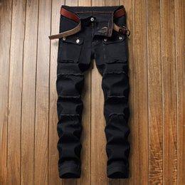 Pantalones de sarga online-A estrenar Jeans para hombre moda apenada cremallera pantalones vaqueros rasgados diseñador del Mens del motorista flaco Pantalones Negro Hip Hop Vaqueros