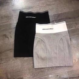 nouvelle mode de conception de jupe Promotion 2019 Nouveau fil de bandage patchwork fermeture à glissière côté imprimé lettre logo femmes design de mode moulante tunique courte jupe crayon tricot jupe