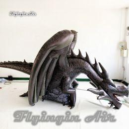 Canada Grand dragon gonflable adapté aux besoins du client de Halloween avec le dragon de vol noir de longueur des ailes 4m pour la construction de toit et la décoration de partie de concert cheap large inflatable decorations Offre
