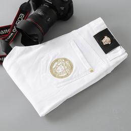 2019 mulheres vestindo uniforme de enfermeiras NO.4S Calças de Brim dos homens Major Marca Estilo Elástico Buraco-in-the-Bottoms Calças Dos Homens Magros Mendigos Pessoal Masculino