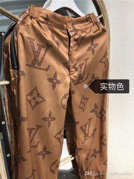 pantalones de mujer de marca Rebajas 19ss diseño de marca de lujo clásico Impresión de logotipo pista de color caqui Pantalones Mujer Dama moda deporte Pantalones de chándal Pantalones de chándal Pantalones de deporte