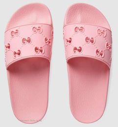 2019 zapatillas planas para niñas Hombres de marca de colores mujeres zapatilla suave moda niño niña letra Slip-on suela de goma deslizante plana sandalia tamaño EU35-45 rebajas zapatillas planas para niñas