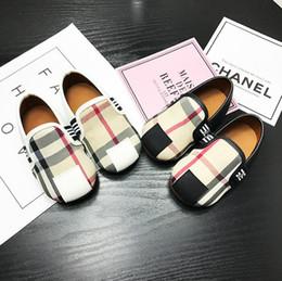 Argentina Diseño de marca niño bebé zapatos casuales moda infantil a cuadros zapatos de los niños en los guisantes de los niños zapatos de fondo blando antideslizante blanco Suministro
