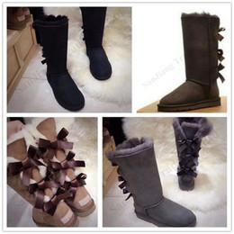 Tubo de botas de mujer online-botas de invierno de la mujer alta del tubo Bowknot cargadores de la nieve de invierno muchachas de las mujeres larga de cuero de arranque Marca Australia ug zapatos de algodón caliente Nueva DesignC102401