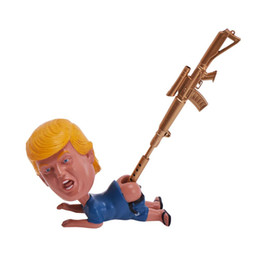 Regali divertenti delle penne online-Hot Donald Trump divertente penna di Natale del basamento del supporto Dump scherzo regalo di compleanno giocattolo divertente del bavaglio del regalo con Trump prodotti finiti