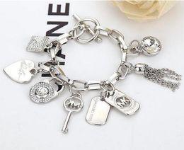 Pendenti chiave per gli uomini online-Braccialetto chiave del pendente del polsino di chiave della nappa di chiave del cuore delle donne del braccialetto di lusso nuovi gioielli