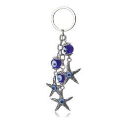 Auto dell'occhio blu online-Ciondolo per auto portachiavi con catena a forma di ciondolo portachiavi blu turchese a forma di stella marina