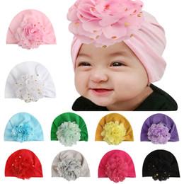 Bambini piccoli fioriscono il ragazzo online-cappelli Kids Designer protezioni del cotone toddle infantile del fiore delle fasce hat principessa ricoprono accessori per capelli bambina bambini le ragazze dei ragazzi simpatici Bandane