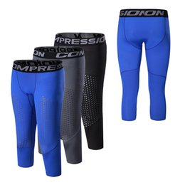 Medias de compresión Gimnasios Pantalones Séptimo Negro Blanco Gris Leggings de secado rápido Pantalones deportivos Pantalones pitillo Gimnasios Ropa deportiva desde fabricantes