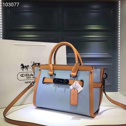 498fa5c46f50 Ladies designer handbags brand wing handbags hardware with dust logo plastic  bag envelope ID card maintenance book 32cmX22x13cm 35798