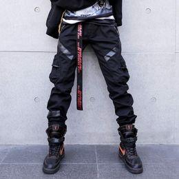 cuero harem Rebajas Hombres High Street Fashion Leather Pocket Splice Casual Cargo Pant Hombre Hip Hop Harem Pantalones Pantalones largos