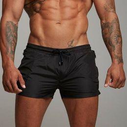 2020 ropa de entrenamiento de musculación Hombres Boardshorts Surf Shorts de playa Entrenamiento deportivo Bodybuilding Summer Shorts Entrenamiento Fitness Swim Wear Sports Gym Pantalones cortos rebajas ropa de entrenamiento de musculación