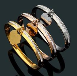 Pulsera 18k envío gratis online-Precio al por mayor de calidad superior de titanio de acero corazón diseño pulsera 3 colores pulsera 18K chapado en oro pulsera envío gratis