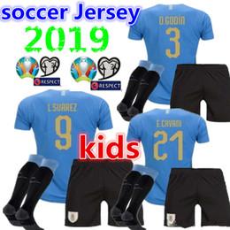 uruguay trikots Rabatt 2019 2020 Kinder Uruguay Hause Fußball Trikotsocken C.STUANI 19 20 Kind D.GODIN Uruguay L.SUAREZ DE ARRASCAETA E.CAVANI Fußball-Set Shirt