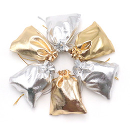 ¡Venta caliente! Bolso del embalaje de la tela de la alta calidad 9x12cm DIY Organza sólida Drawable PouchesBags Joyería Embalaje de la boda 100pcs Barato desde fabricantes