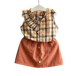 2019 filles chaudes de vente d'été nouveaux enfants costume marée chemise à carreaux jupe marron ? partir de fabricateur