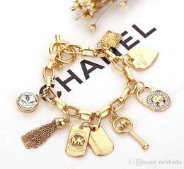 Gemas de plata de ley online-Pulseras de la llave de la aleación con el amor del corazón de la gema 925 colgantes plateados del oro de la plata esterlina Charm Bracelets Bangle Jewelry para hombres mujeres B029