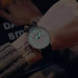 Relojes con esfera grande Tendencia de los hombres Cinturón ultrafino Relojes de luz nocturna Versión coreana para hombres Moda simple Reloj de cuarzo impermeable desde fabricantes