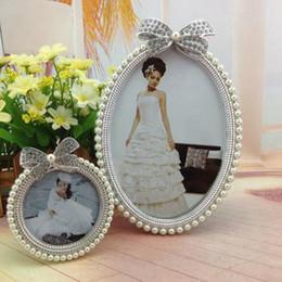 Foto marco perla online-Foto fotos marco cristalino de la perla del Bowknot del diamante oval del boda del marco lindo de la foto del hogar regalo de la decoración Nueva 3 pulgadas y 6 pulgadas
