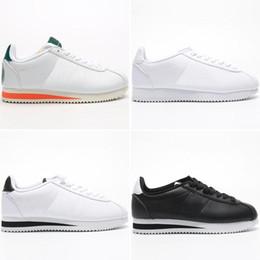 Classique Designer Cortez en cuir haut Qaulity Hommes Femmes Nouveau Mode Triple Blanc Noir Rose chaussures de sport Eur36 44