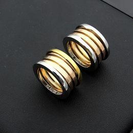 316L titanio par de acero versión estrecha cuarto de resorte anillo de tres colores anillo de oro rosa resorte accesorios de joyería desde fabricantes