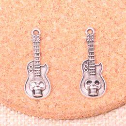 2019 fare chitarre 100 pz Charms chitarra teschio antico argento placcato pendenti misura gioielli facendo risultati accessori 32 * 11mm fare chitarre economici