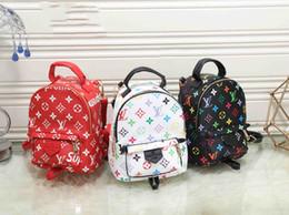 Dimensioni delle borse scolastiche online-Mini Zaino Reverse School Bag Donna Luxury Designers Zaino Borse M41562 Dimensioni 16 * 8 * 21cm PALM SPRINGSLouisvuitton