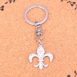 Fleur lis ring men online shopping - Novelty Souvenir Metal fleur de lis saints Key Chains Creative Gifts Apple Keychain Key Ring Trinket Car Key Ring