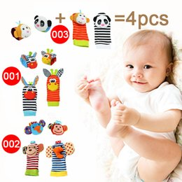 Baby Hand Rattles Wholesale NZ - Wholesale- 2pcs wrist + 2pcs socks Baby Infant Soft Handbells Hand Wrist Strap Rattles Animal Socks Newborn Finders Stuffed Christmas Toys