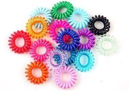 Atacado-100Pcs em um pacote elástico arco-íris colorido telefone fio cabo de cabelo banda laços Banda Corda Bobbles E715 em Promoção