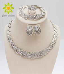 Envío gratis 2015 forma de hojas plateadas cristal claro conjunto de joyas Nueva moda de bodas nupcial conjunto de joyas africanas en venta