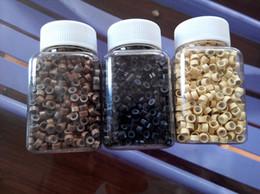 1000 unids / jar I Punta perlas de pelo micro anillos de silicona enlaces para extensiones de cabello rubio marrón (5.0x2.8x3.0mm) en venta