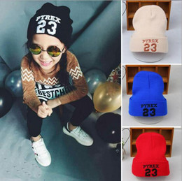 China Wholesale wholesale children's hat, autumn and winter boys and girls new version of the alphabet 23 baby knitting wool cap suppliers