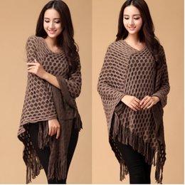 Ladies Knit Ponchos Pas Cher-Évider Coat New Fashion Knit ponchos Loisirs Cardigan Knitting Lady Batwing Cape Tassel Poncho Tricots Châle Wraps Cardigan