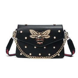 Chinese  2017 famous brand women designer handbags luxury star same style handbags crossbody shoulder bags with metal chains and strip clutch bags manufacturers