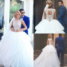 Tulle Jewel Neckline Wedding Dress Canada - Modern Tiered Lace Wedding Dresses 2016 Sheer Applique Jewel Neckline Tulle A-line Hollow Back Bridal Ball Gowns Sweep Train