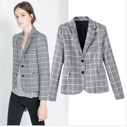 Go for fashion with your silhouette this season with this classic check blazer featuring double breasted buttons and wide collar. Perfect to smarten up your jeans and tee look or wear over a pretty mini skirt and tee for an alternative spin on this versatile blazer.