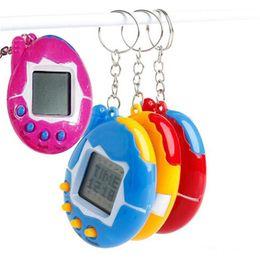 Vente en gros New Hot Mixed couleurs Tamagotchi Jouets avec pile bouton Rétro Jeu Virtual Pets jouet électronique pour enfants cadeau de fête de Noël
